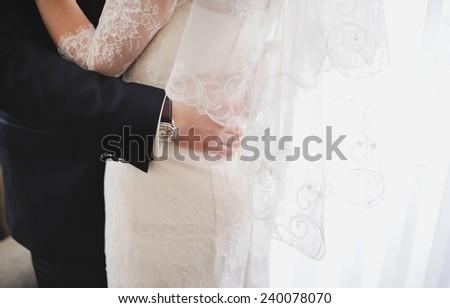 young wedding couple. embracing indoors - stock photo