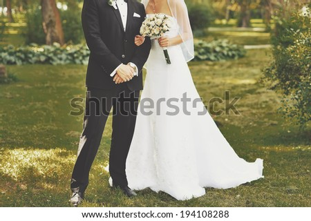 Young wedding couple. Groom and bride together. - stock photo