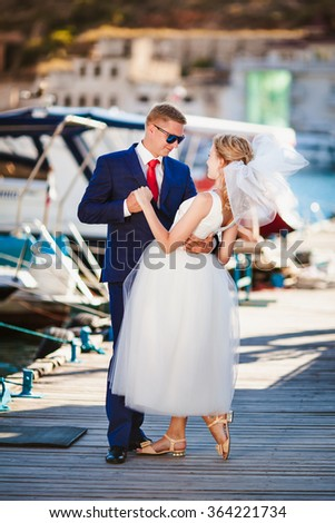 Young wedding couple hugging by the sea background - stock photo