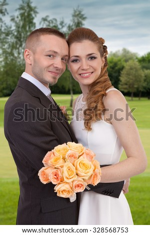 Young wedding couple in the park