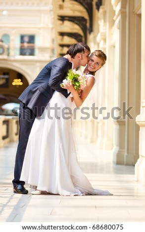 Young wedding couple indoors. Bright white colors. - stock photo