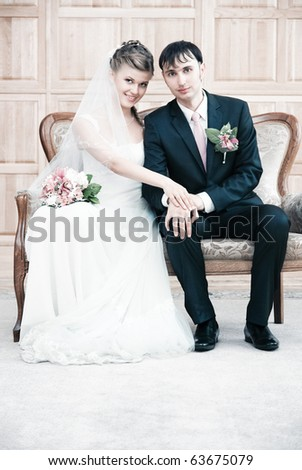 Young wedding couple interior portrait. Bright white colors. - stock photo