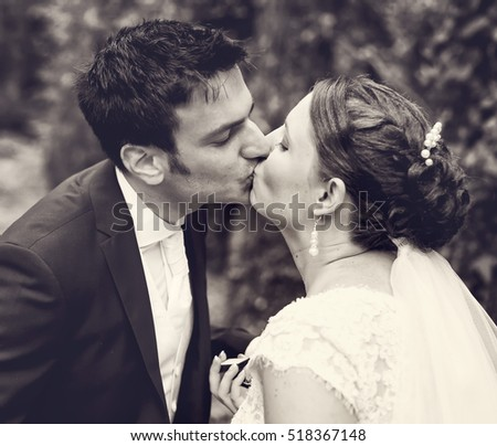 Young wedding couple kissing outdoor