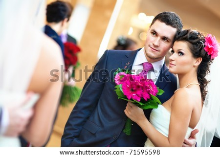 Young wedding couple looking at mirror. - stock photo