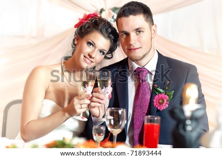 Young wedding couple on party.