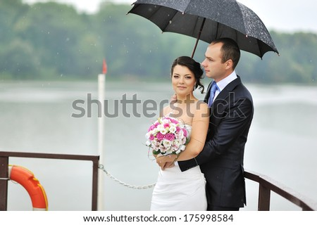 Young wedding couple outdoor portrait