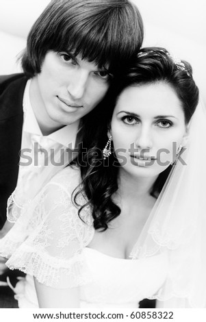 Young wedding couple portrait. Black and white colors.