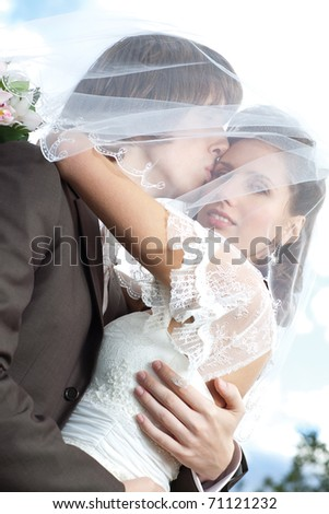 Young wedding couple portrait. Bright white colors. - stock photo