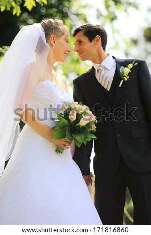 Young wedding couple preparing kissing