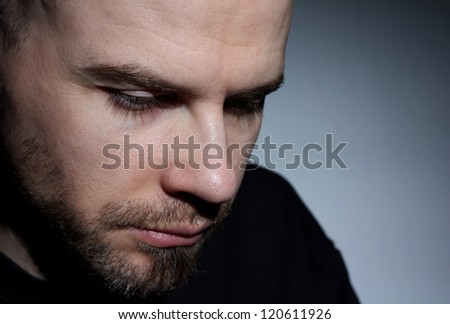 Young white guy looking depressed close up