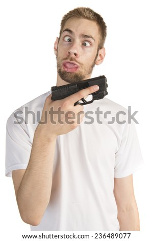 Young white male in his 20s holding a .45 ACP handgun  like a stupid idiot, isolated on white background