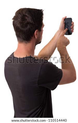 Young White Man In Black T-Shirt Working On His Smartphone