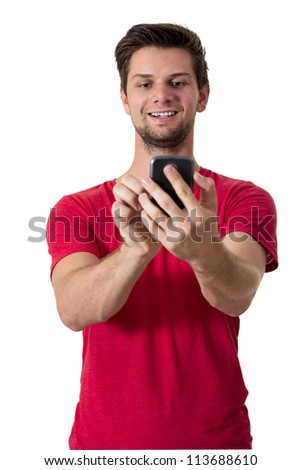 Young White Man In Red T-Shirt Working On His Smartphone