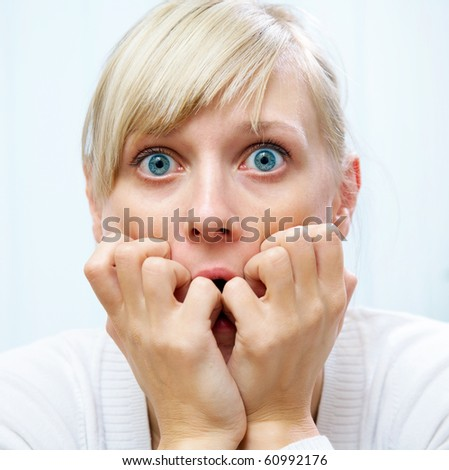 young white woman was frightened and covered her mouth with her hands - stock photo