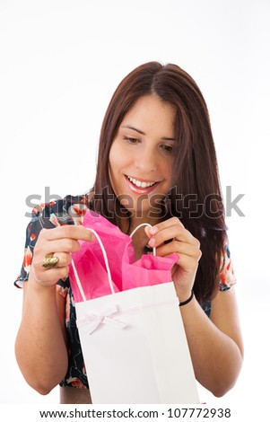young woman accepting gifts for a special occasion - stock photo