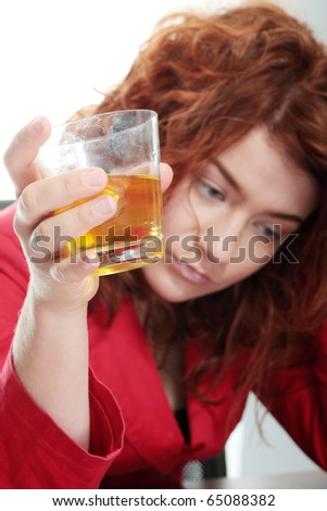 Young woman addicted to alcohol, isolated on white - stock photo