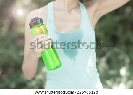 Young woman after long run at park - stock photo
