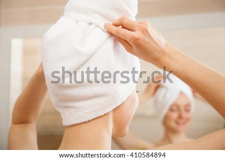 Young woman after morning shower in a bathroom - stock photo
