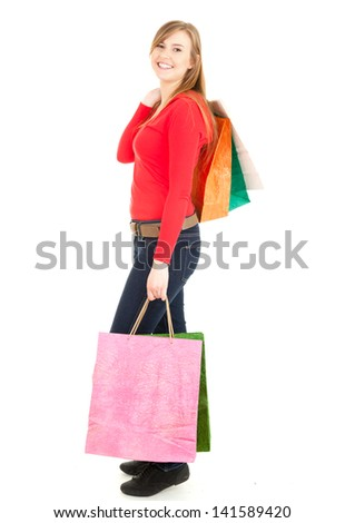 young woman after shopping, full lenght, white background - stock photo