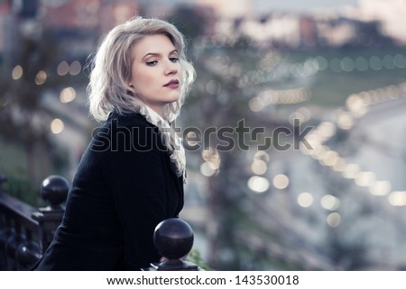 Young woman against a night city lights - stock photo