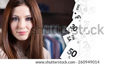 Young woman against the background of clothes and discount labels. Good  shopping concept - stock photo