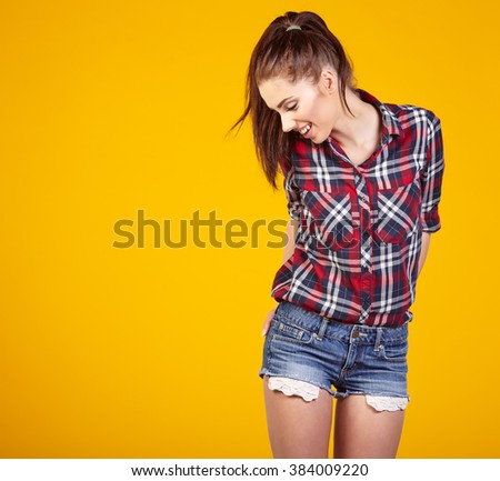 Young Woman against yellow background