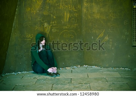 Young woman alone in urban background.