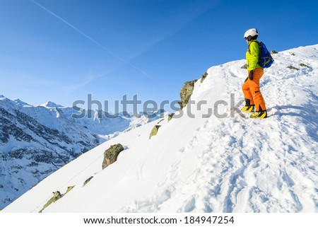 Young woman alpine skier on ascent to top of a mountain, Austrian Alps, Riffelsee Pitztal.