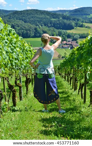 Young woman among vineyards. Switzerland - stock photo