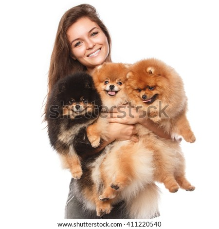 Young woman and cute spitz dogs on white background - stock photo