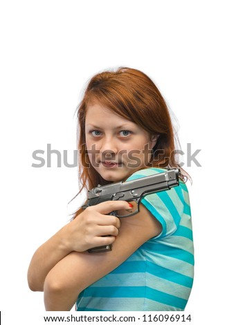 Young woman and gun isolated on white background - stock photo