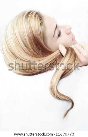young woman and her beautiful hairstyle - stock photo