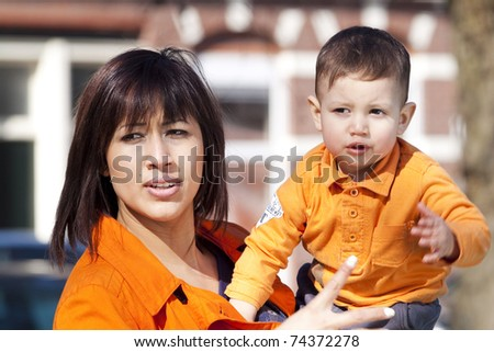 Young woman and her child. - stock photo