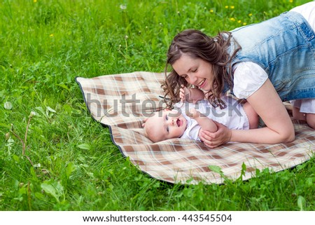 young woman and her cute baby girl outdoor  - stock photo