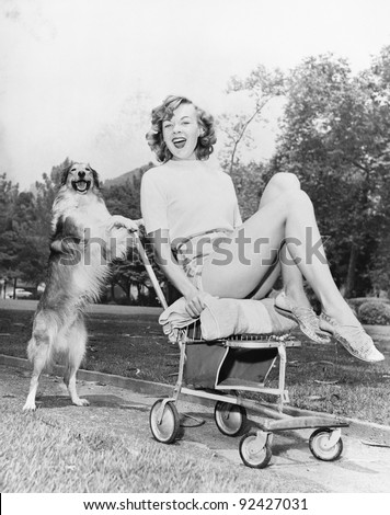 Young woman and her pushy pet dog - stock photo