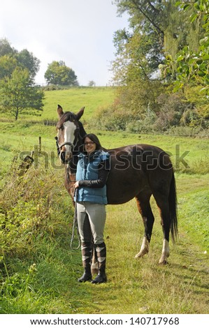 Young woman and horse - stock photo