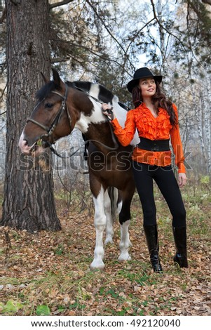 Young woman and horse in a forest