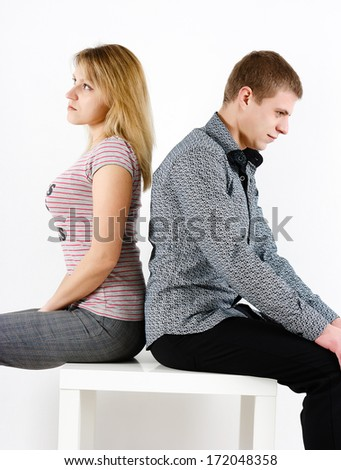 young woman and man sitting turned away. quarrel - stock photo