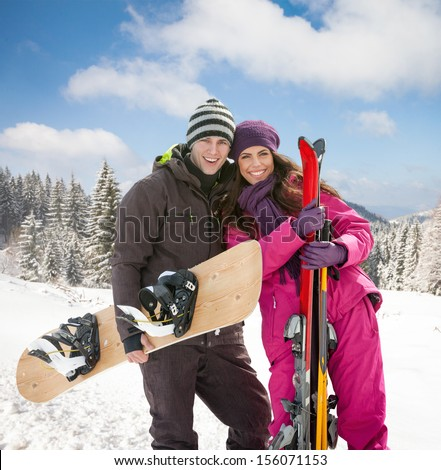 young woman and man skiers on winter day