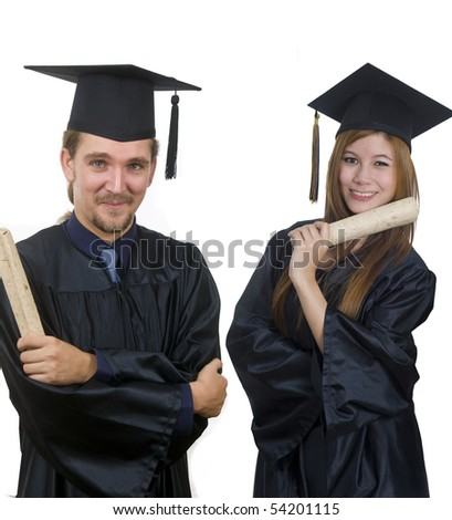 Young woman and man with graduation cap and gown - stock photo