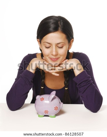Young woman and piggy bank saving money. - stock photo