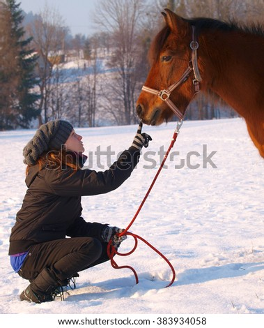 Young woman and pony - stock photo