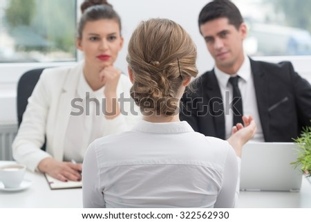 Young woman and recruitment procedure in corporation - stock photo