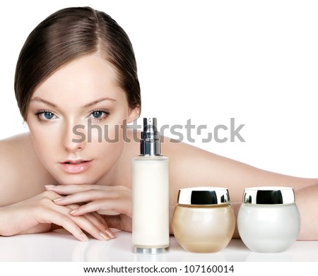young woman and skincare products. Space for text. - stock photo