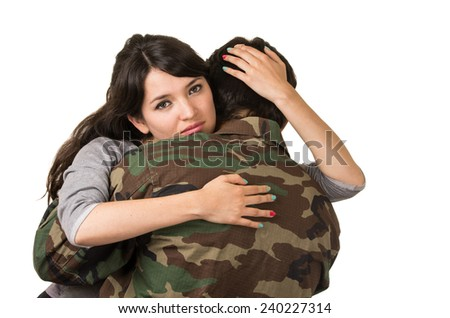 young woman and soldier in military uniform say goodbye deployment isolated on white - stock photo