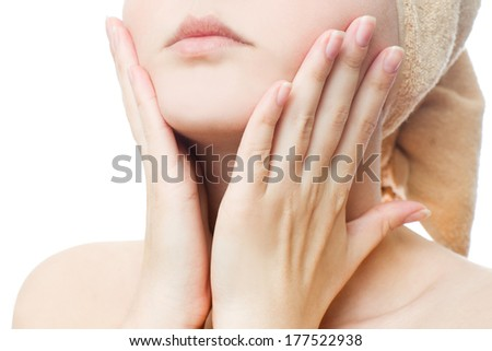 Young woman applies cream on face - stock photo