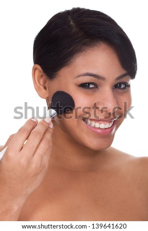 Young Woman Applying Blush Over White Background