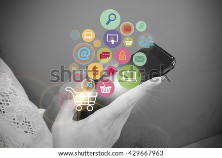 Young woman are using shopping cart with application software icons as business shopping online concept , black and white background image