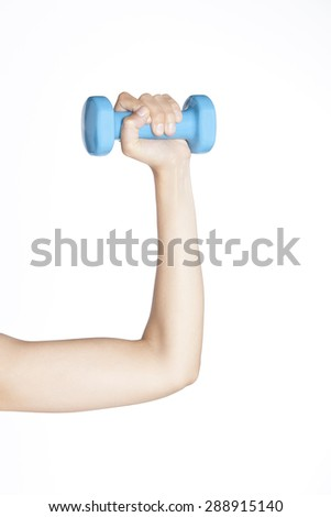 Young woman arm holding a dumbbell on a white background. - stock photo