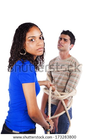 Young woman arresting a youg man with a rope (isolated on white) - stock photo